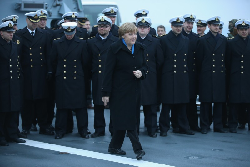 "German Chancellor Angela Merkel walks past sailors of the German Navy while visiting the ""Braunschweig"" warship on January 19, 2016 in Kiel, Germany."
