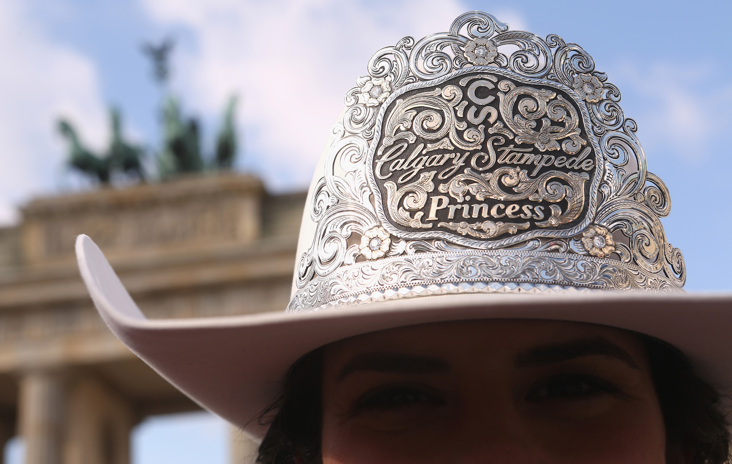 BERLIN, GERMANY - MARCH 09:  (EXCLUSIVE COVERAGE) 2018 Calgary Stampede Princess Jaden Holle poses at the Brandenburg Gate as the group visits Germany to participate in the Internationale Tourismus-Boerse Berlin (ITB) tourism trade fair, where they present Canadian Western culture and First Nation Heritage, on March 9, 2018 in Berlin, Germany. The Calgary Stampede is an annual ten-day rodeo festival in Canada. The event, featuring one of the world's largest rodeos, attracts over one million visitors per year. Each year, an Indian Princess is selected from one of the five nations group of Native Americans as part of the Stampede's 'royalty.'  (Photo by Adam Berry/Getty Images)