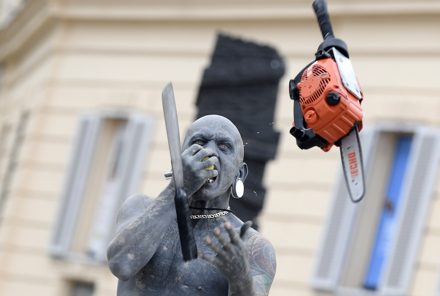 The worlds most tattooed man, Gregory Paul Mclaren, performs as Lucky Diamond Rich during a photo session on March 14 in Vienna, Austria. / AFP PHOTO / APA / HANS KLAUS TECHT / Austria OUT        (Photo credit should read HANS KLAUS TECHT/AFP/Getty Images)