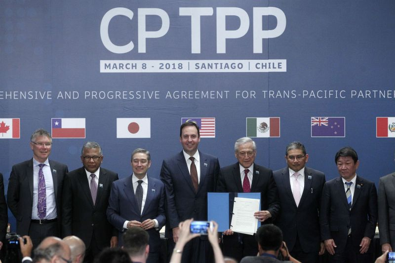 With the U.S. bailing out, the remaining 11 countries forged ahead and signed a revised Pacific trade pact in Santiago, Chile, Mar. 8, 2018. (Claudio Reyes/AFP/Getty Images)