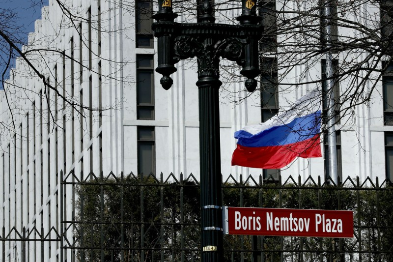 The Russian flag flies in front of its embassy in Washington on March 26. (Chip Somodevilla/Getty Images)