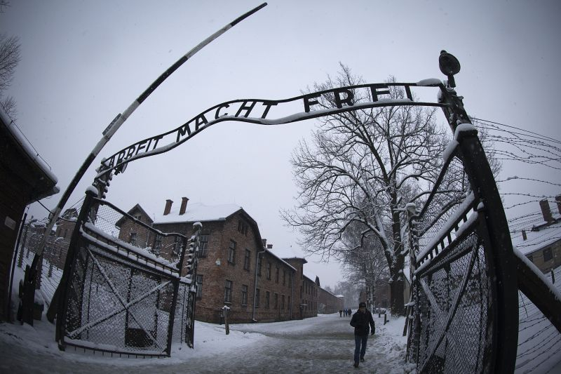 A visitor at the entrance of the memorial site of the former Nazi concentration camp Auschwitz-Birkenau in Oswiecim, Poland, on Jan. 25, 2015. (Joel Saget/AFP/Getty Images)