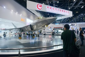 A man looks at a J-31 Gyrfalcon stealth fighter plane model designed by Aviation Industry Corporation of China at the Beijing International Aviation Expo on Sept. 17, 2015. WANG ZHAO/AFP/Getty Images