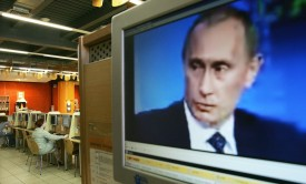 Russian President Vladimir Putin on a computer screen in an internet cafe in Moscow. (DENIS SINYAKOV/AFP/Getty Images)