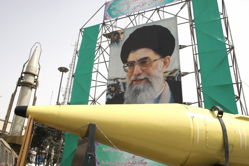 Iranian Shahab-2 and Shahab-3 missiles stand on display in front of a large portrait of Iran's Supreme Leader Ayatollah Ali Khamenei in a square in south Tehran on Sept. 28, 2008. (ATTA KENARE/AFP/Getty Images)