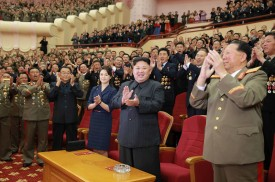 North Korean leader Kim Jong-Un  attending an art performance dedicated to nuclear scientists and technicians. (Photo credit should read STR/AFP/Getty Images)