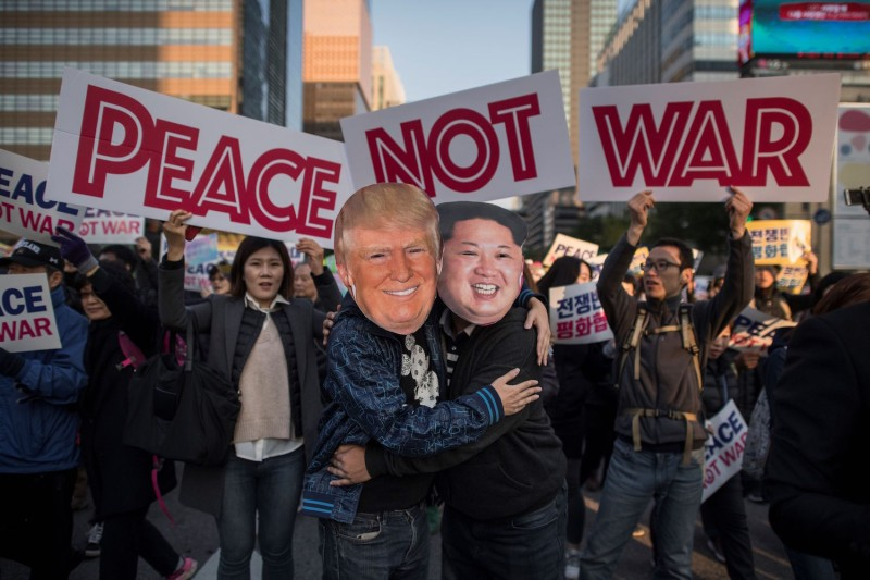 Demonstrators dressed as North Korean leader Kim Jong Un and U.S. President Donald Trump embrace during a peace rally in Seoul on November 5, 2017.  ED JONES/AFP/Getty Images
