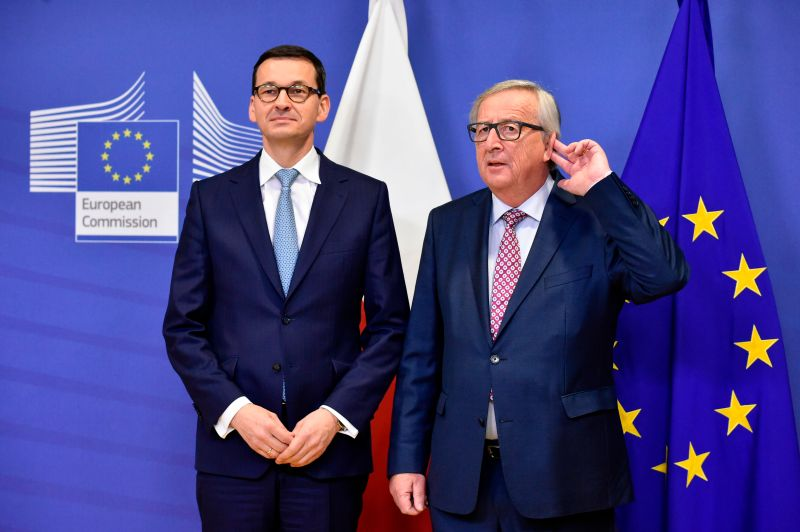 European Commission President Jean-Claude Juncker (right) welcomes Polish Prime Minister Mateusz Morawiecki in Brussels on Jan. 9.  (JOHN THYS/AFP/Getty Images)