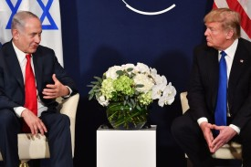 U.S. President Donald Trump, right, speaks with Israeli Prime Minister Benjamin Netanyahu during a bilateral meeting on the sidelines of the World Economic Forum annual meeting in Davos, Switzerland, on Jan. 25. (Nicholas Kamm/AFP/Getty Images)