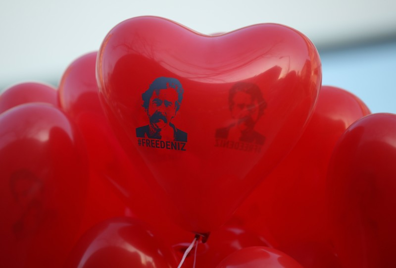 "Red balloons in the shape of a heart that read: ""Free Deniz"" in reference to Deniz Yucel, a German-Turkish journalist imprisoned in Turkey. (Sean Gallup/Getty Images)"