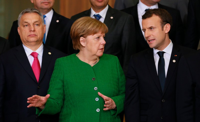 Hungarian Prime Minister Viktor Orban, German Chancellor Angela Merkel and French President Emmanuel Macron at the European Commission in Brussels on February 23, 2018. (OLIVIER HOSLET/AFP/Getty Images)