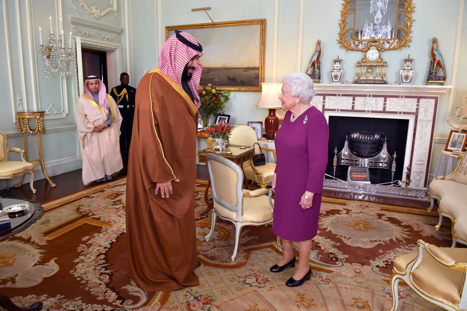 TOPSHOT - Britain's Queen Elizabeth II greets Saudi Arabia's Crown Prince Mohammed bin Salman at Buckingham Palace in central London on March 7, 2018. Salman, who is on a three day visit to the UK, will lunch Wednesday with the Queen at Buckingham Palace, while Prince Charles will host him at a dinner with Prince William among the guests. The crown prince will jointly host with May the inaugural UK-Saudi strategic partnership council in No. 10, the prime minister's office and residence.  / AFP PHOTO / Dominic Lipinski        (Photo credit should read DOMINIC LIPINSKI/AFP/Getty Images)
