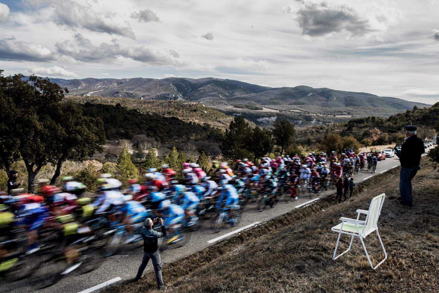 TOPSHOT - The pack rides during the 165km fifth stage of the 76th Paris-Nice cycling race between Salon de Provence and Sisteron on March 8, 2018. / AFP PHOTO / JEFF PACHOUD        (Photo credit should read JEFF PACHOUD/AFP/Getty Images)