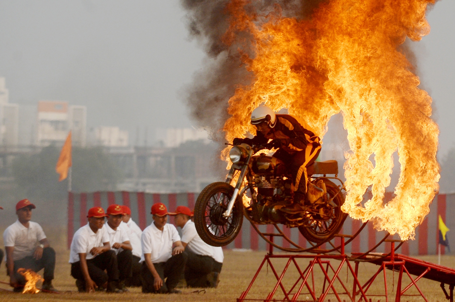 TOPSHOT - An Indian army soldier member of the 'Tornadoes' motorcycle display team rides rings of fire during a combined display at an officer training academy in Chennai on March 9, 2018. / AFP PHOTO / ARUN SANKAR        (Photo credit should read ARUN SANKAR/AFP/Getty Images)
