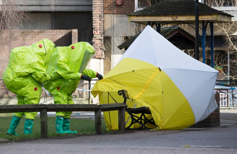 Specialist officers in protective suits secure the police forensic tent that had been blown over by the wind and is covering the bench where Sergei Skripal was found ill with his daughter on March 4. Matt Cardy/Getty Images