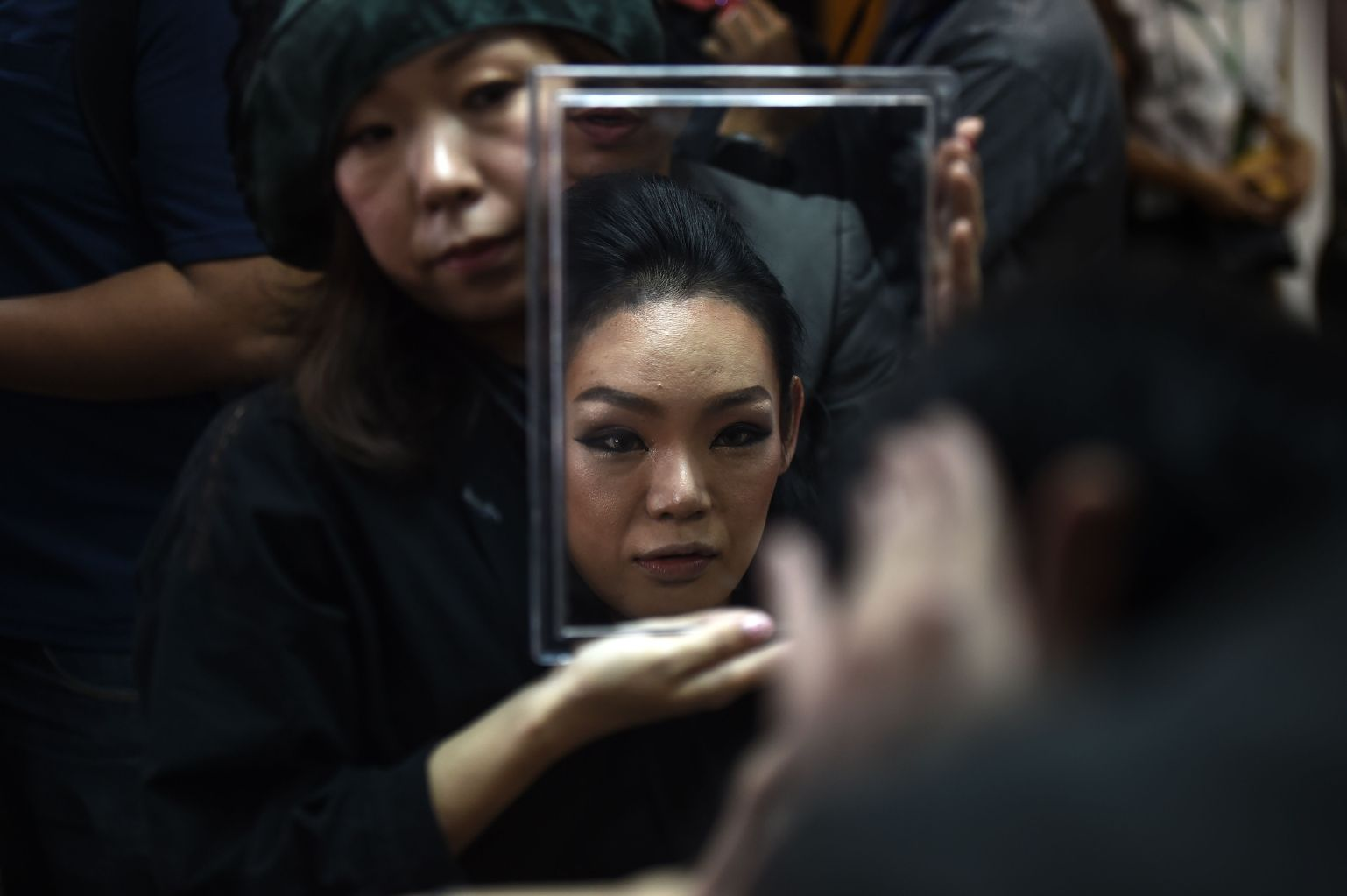 TOPSHOT - Yuko of Japan gets ready in the dressing room before the final round of the Miss International Queen 2018 transgender beauty pageant in Pattaya on March 9, 2018. / AFP PHOTO / LILLIAN SUWANRUMPHA        (Photo credit should read LILLIAN SUWANRUMPHA/AFP/Getty Images)