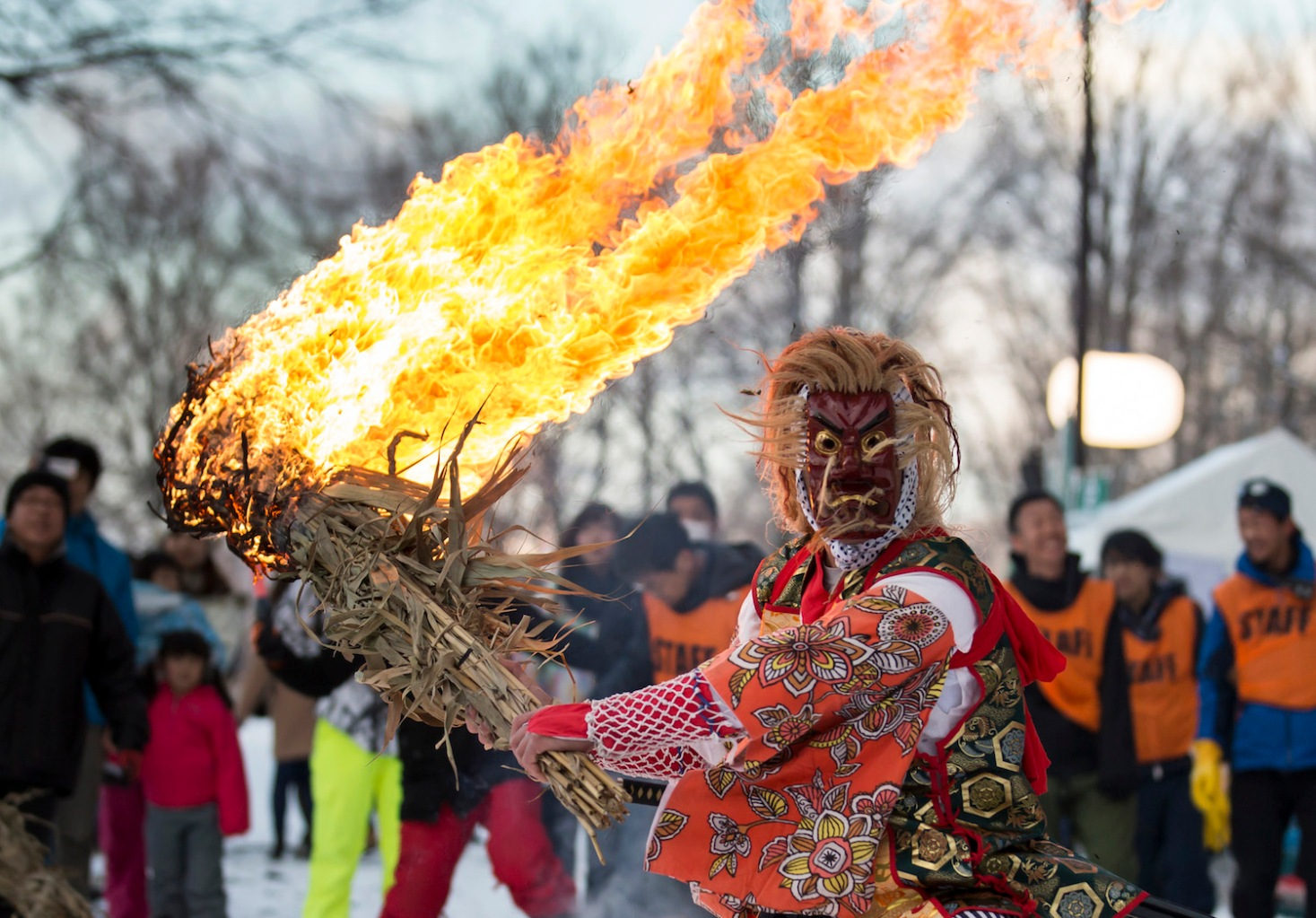 A man wearing a mask of Tengu, a legendary creature in Japanese folklore, holds a flaming torch during a ceremony held ahead of the Tsunan Sky Lantern event on March 10, in Tsunan, Japan. About 2,000 lanterns were released at the event which began in commemoration of victims of the earthquake that hit the region March 12, 2011 and has grown to attract tourists marking the end of the town's snow season, known as one of the heaviest snowfall areas in Japan. (Photo by Tomohiro Ohsumi/Getty Images)
