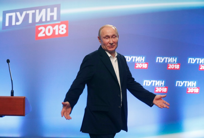 President Vladimir Putin meets with the media at his campaign headquarters in Moscow on March 18, 2018. SERGEI CHIRIKOV/AFP/Getty Images