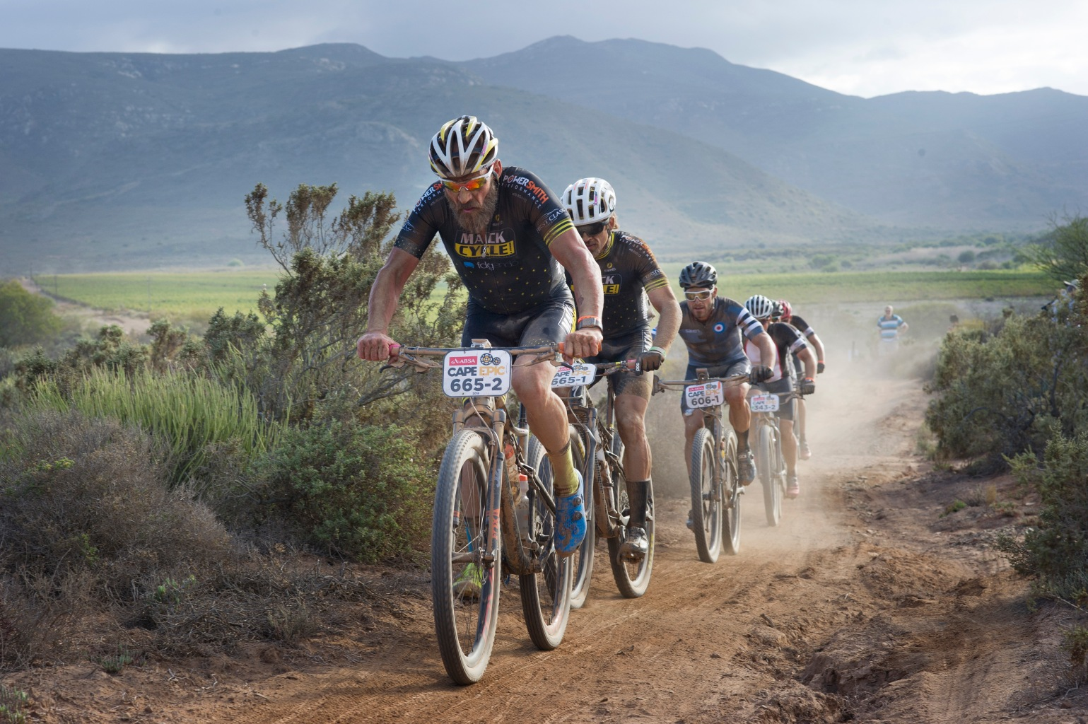 TOPSHOT - Participants ride during the first full stage of the 2018 Cape Epic African Mountain Bike Race on March 19, 2018, in the mountainous region close to the town of Robertson, about 150 Km from  Cape Town.  The Epic, which is regarded as one of the world's foremost mountain bike races, covers a distance of 685Km, and climbs 13530m, over 8 stages, through the mountains of the Western Cape Province. The riders ride in teams of two, and have to finish close together / AFP PHOTO / RODGER BOSCH        (Photo credit should read RODGER BOSCH/AFP/Getty Images)