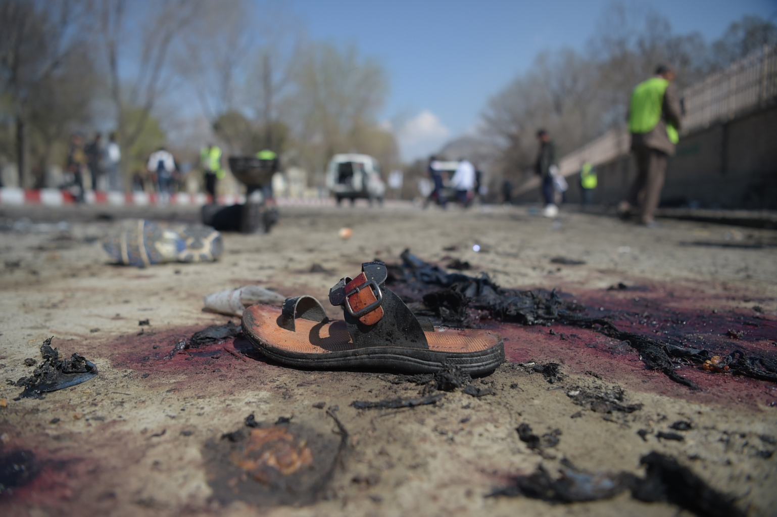 TOPSHOT - A sandal is seen laying on the ground along a road at the site of a suicide bombing attack in Kabul on March 21, 2018.  A suicide bomber on March 21 killed at least 26 people, many of them teenagers, in front of Kabul University, officials said, as Afghans took to the streets to celebrate the Persian new year holiday. The Islamic State group claimed responsibility for the deadly attack -- the fifth suicide bombing in the Afghan capital in recent weeks -- via its propaganda arm Amaq, SITE Intelligence Group said. The Taliban earlier denied involvement on Twitter.  / AFP PHOTO / SHAH MARAI        (Photo credit should read SHAH MARAI/AFP/Getty Images)