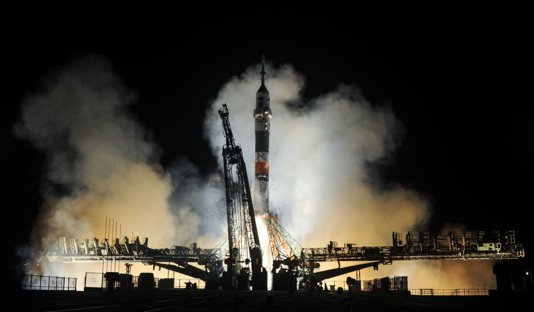 TOPSHOT - Russia's Soyuz MS-08 spacecraft carrying the members of the International Space Station (ISS) expedition 55/56, NASA astronauts Andrew Feustel and Richard Arnold and Roscosmos cosmonaut Oleg Artemyev, blasts off to the ISS from the launch pad at the Russian-leased Baikonur cosmodrome on March 21, 2018. / AFP PHOTO / VYACHESLAV OSELEDKO        (Photo credit should read VYACHESLAV OSELEDKO/AFP/Getty Images)