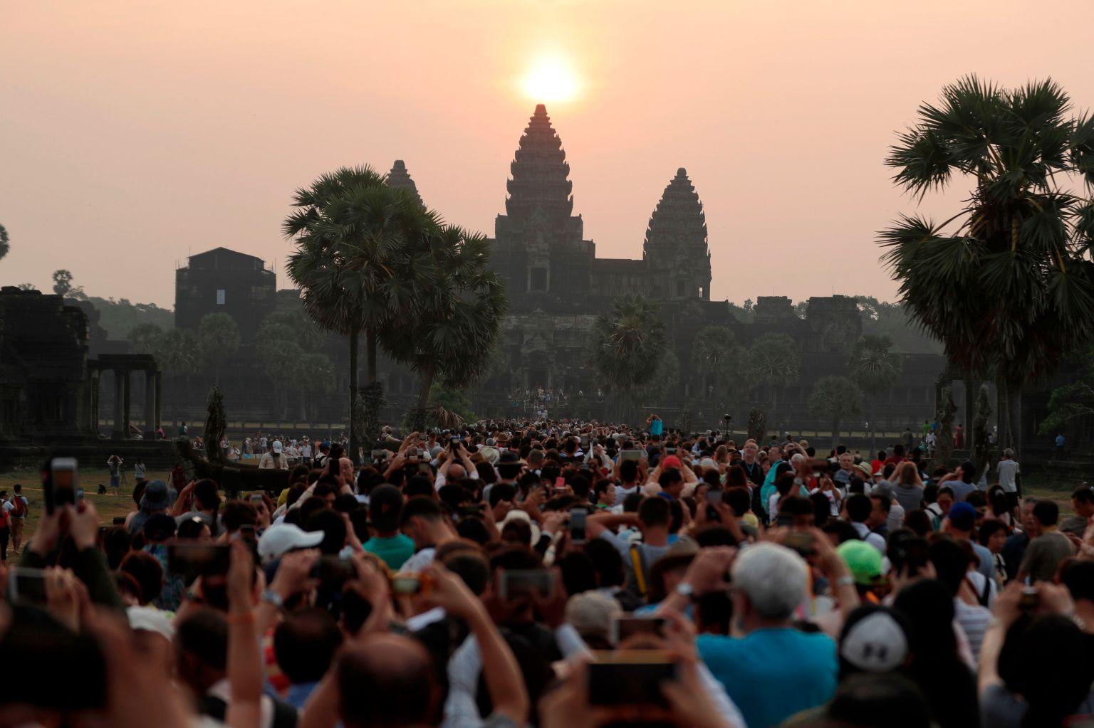TOPSHOT - In this photograph taken on March 22, 2018, the sun rises over the central stupa of Angkor Wat temple in Siem Reap.  The well preserved remains of the Khmer Empire from the 9th to the 15th century is one of the most important archaeological sites in Southeast Asia and Cambodia's top tourist attraction.  / AFP PHOTO / -        (Photo credit should read -/AFP/Getty Images)