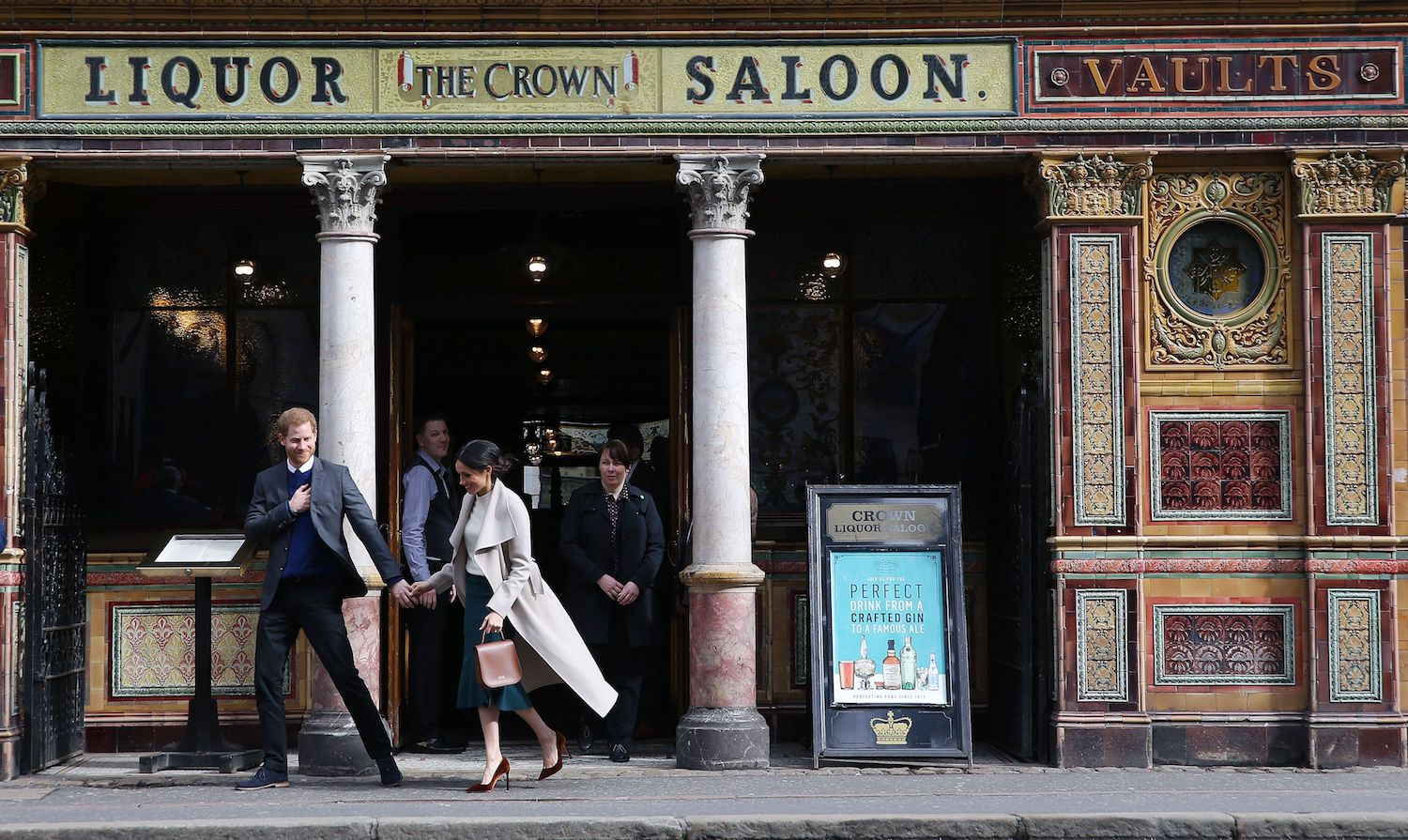 Britain's Prince Harry (L) and Prince Harry's fiancee, US actress Meghan Markle leave after a visit to one of Belfast's most historic buildings, The Crown Liquor Saloon, a former Victorian gin palace, now run by the National Trust, on March 23, 2018, during the Royal Couple's first joint visit to Northern Ireland. / AFP PHOTO / POOL / Kelvin BOYES        (Photo credit should read KELVIN BOYES/AFP/Getty Images)