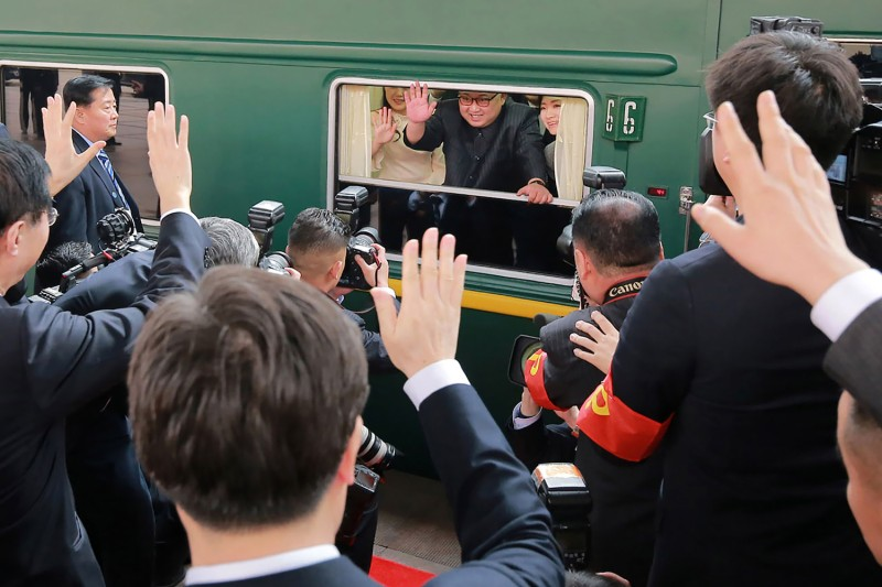 North Korean leader Kim Jong Un waves from his train as it prepares to depart from Beijing railway station. (-/AFP/Getty Images)