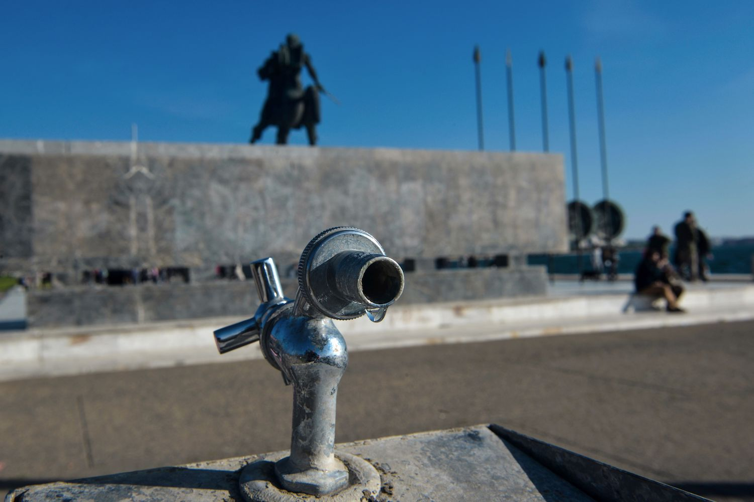 A dripping tap is pictured next to a statue of Alexander the Great on the 3rd day in a row without water in Thessaloniki on March 29, 2018. More than 40 percent households and businesses in Greece's second largest city have been without tap water, due to damage in the main water pipeline.  / AFP PHOTO / SAKIS MITROLIDIS        (Photo credit should read SAKIS MITROLIDIS/AFP/Getty Images)