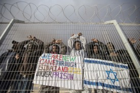 African asylum-seekers protest at the Holot detention center in Israel's Negev Desert, on Feb. 17, 2014. (Jack Guez/AFP/ Getty Images)