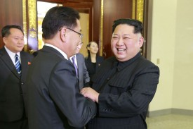 North Korean leader Kim Jong Un, right, shaking hands with South Korean envoy Chung Eui-yong in Pyongyang on March 5. (AFP/KCNA via KNS/Getty Images)