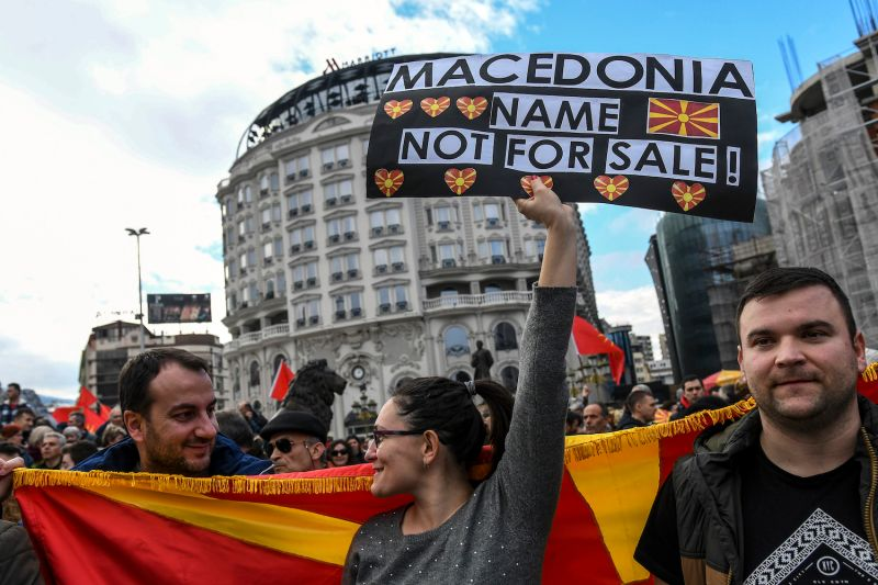People wave Macedonian flags during a protest in a central square in Skopje on March 4. Right-wing and diaspora organizations protested against a possible compromise with Greece on the country's name  which they say would damage the national interest. (Robert Atanasovski/AFP/Getty Images)
