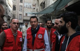 Peter Maurer, president of the International Committee of the Red Cross, talks with aid workers after arriving in Eastern Ghouta on March 15, 2018. (Al-Ajweh/AFP/Getty Images)