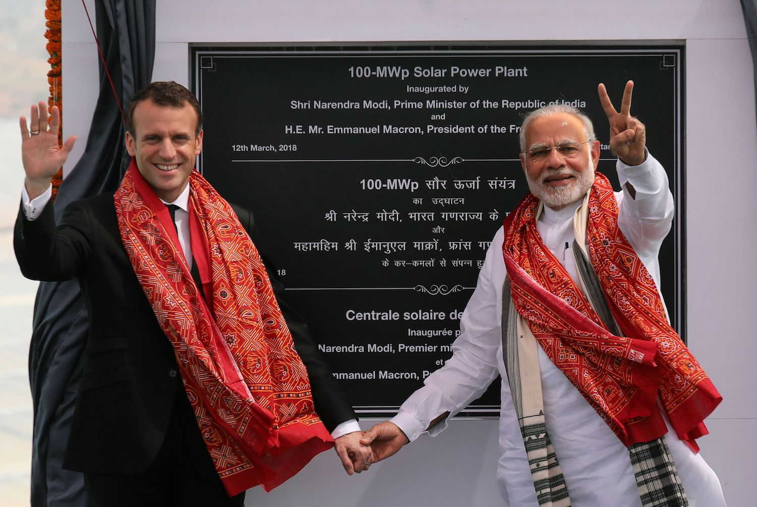 Indian Prime Minister Narendra Modi (r) and French President Emmanuel Macron pose for photographers at the opening of a solar power plant in Mirzapur on March 12. French President Emmanuel Macron March 11 pledged hundreds of millions of dollars for solar projects in developing countries, as world leaders met in India to promote greater investment in renewable energy.  / AFP PHOTO / POOL / Ludovic MARIN        (Photo credit should read LUDOVIC MARIN/AFP/Getty Images)