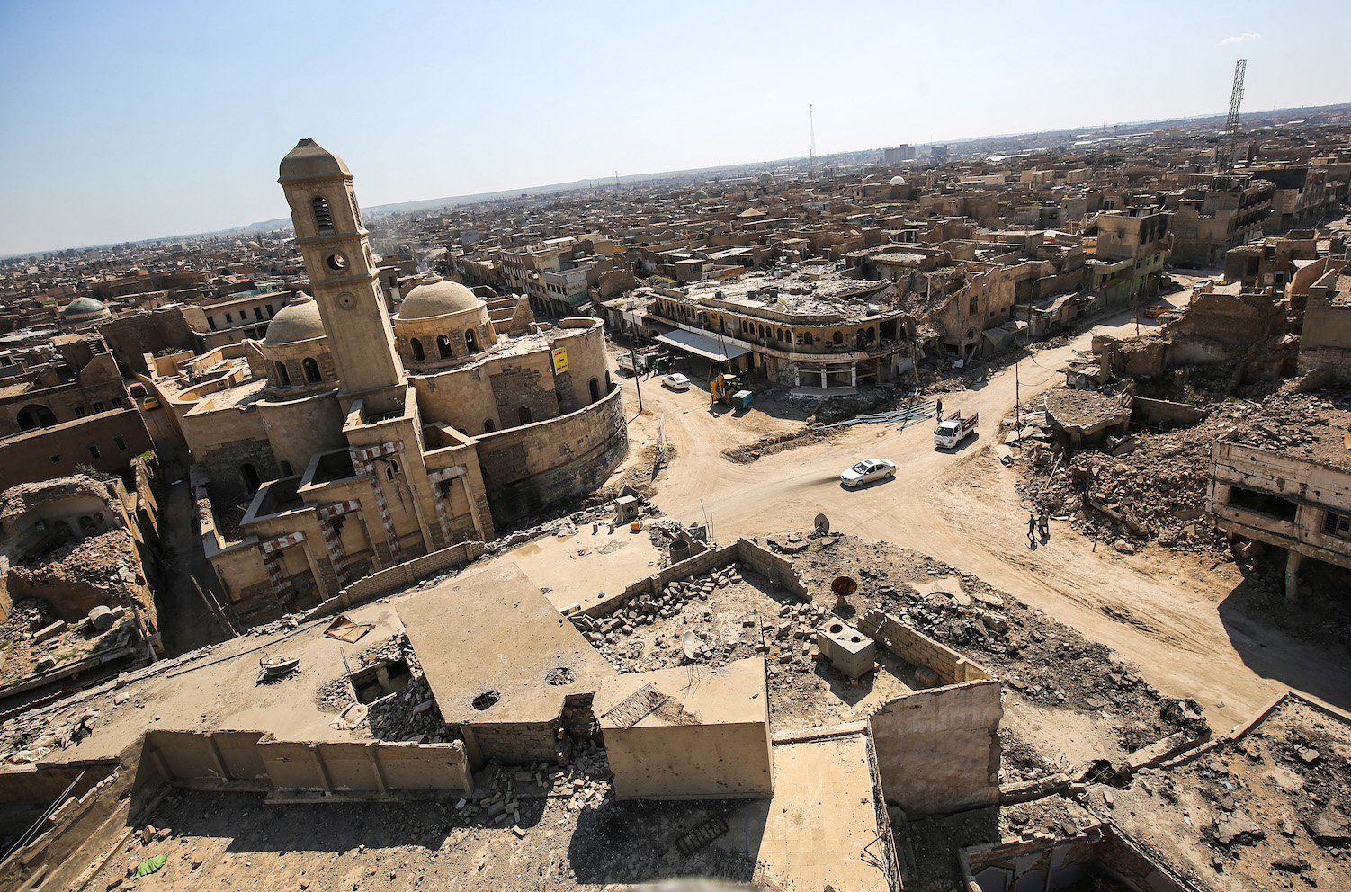 A picture taken on March 14, shows a view of destruction surrounding the Roman Catholic Church of Our Lady of the Hour (l) in the old city of Mosul, eight months after it was retaken by Iraqi government forces from the control of Islamic State (IS) group fighters. / AFP PHOTO / AHMAD AL-RUBAYE        (Photo credit should read AHMAD AL-RUBAYE/AFP/Getty Images)
