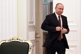 Russian President  Vladimir Putin enters a hall to meet with other candidates a day after the presidential election, at the Kremlin in Moscow on March 19, 2018.