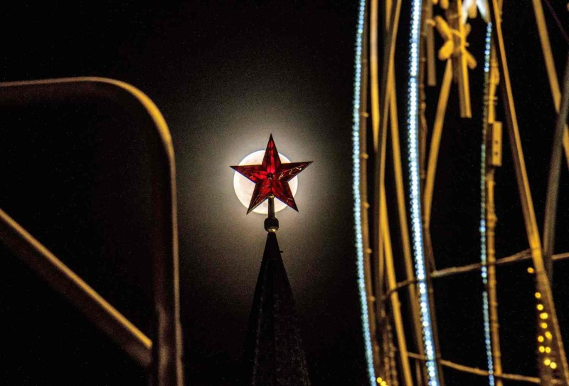 The full moon rises behind one of the Kremlin ruby stars in Moscow on March 1. During a two-hour speech to a joint sitting of both houses of parliament Russia's President Vladimir Putin claimed his country has developed a new array of nuclear weapons that are invincible. (Mladen Antonov/AFP/Getty Images)