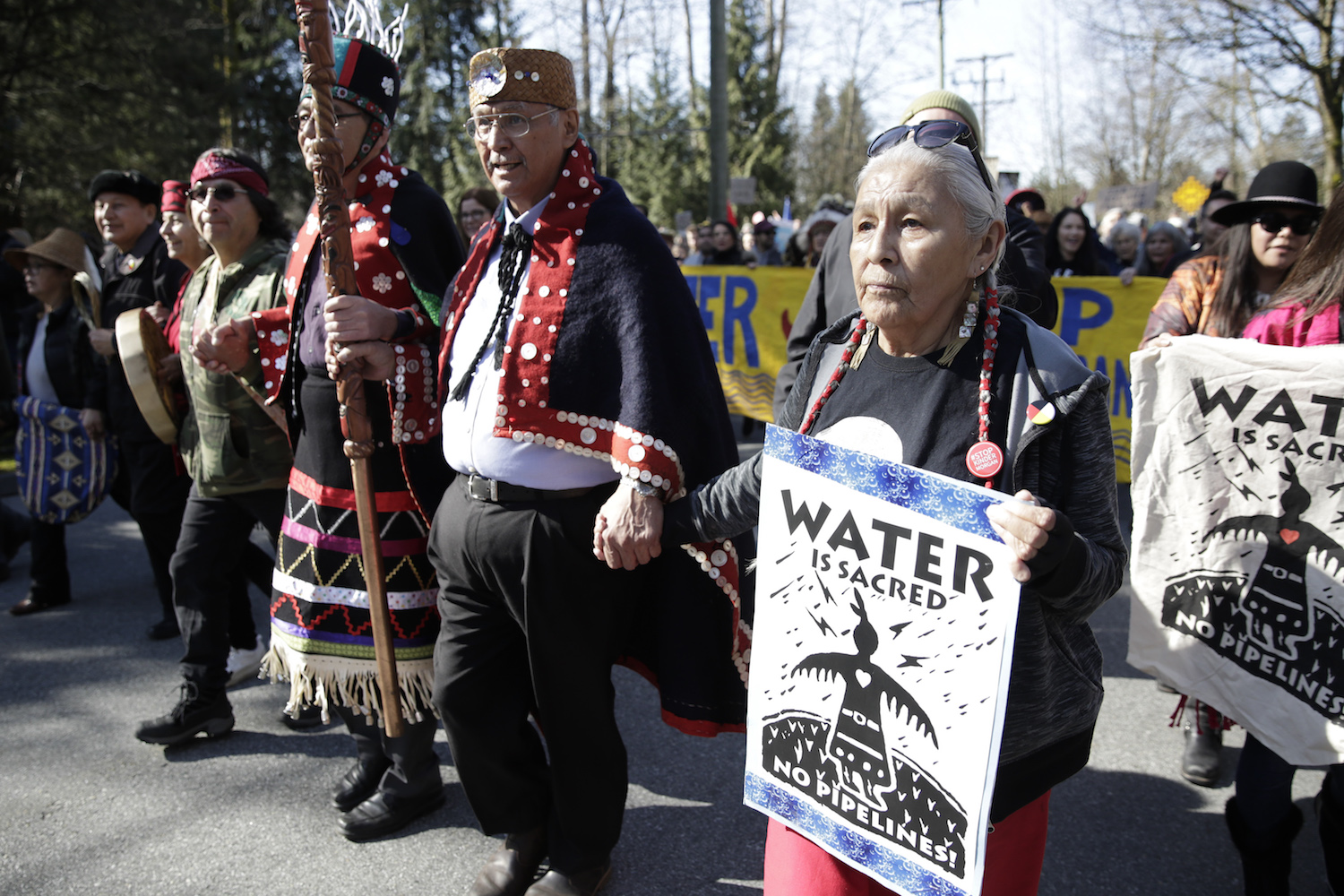 Harriet Prince (r), 76, of the Anishinaabe tribe marches with Coast Salish Water Protectors and others against the expansion of Texas-based Kinder Morgan's Trans Mountain pipeline project in Burnaby, British Columbia, Canada on March 10, 2018.  / AFP PHOTO / Jason Redmond        (Photo credit should read JASON REDMOND/AFP/Getty Images)