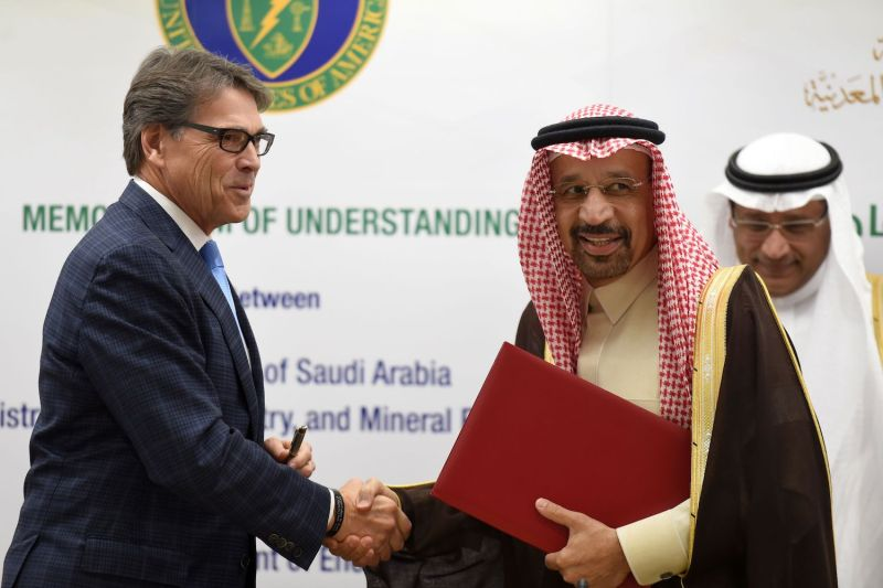 U.S. Energy Secretary Rick Perry (left) and Saudi Energy Minister Khaled al-Falih (right) shake hands after a signing ceremony of a memorandum understanding on carbon management between Saudi Arabia and the U.S., on Dec. 4, 2017 in Riyadh. (Fayez Nureldine/AFP/Getty Images)