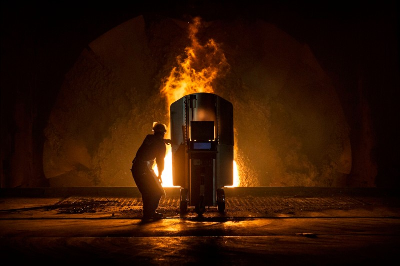 A worker tests the quality of molten iron at a furnace in the production area of the Zhong Tian (Zenith) Steel Group Corporation in Changzhou, Jiangsu province, China on May 12, 2016.