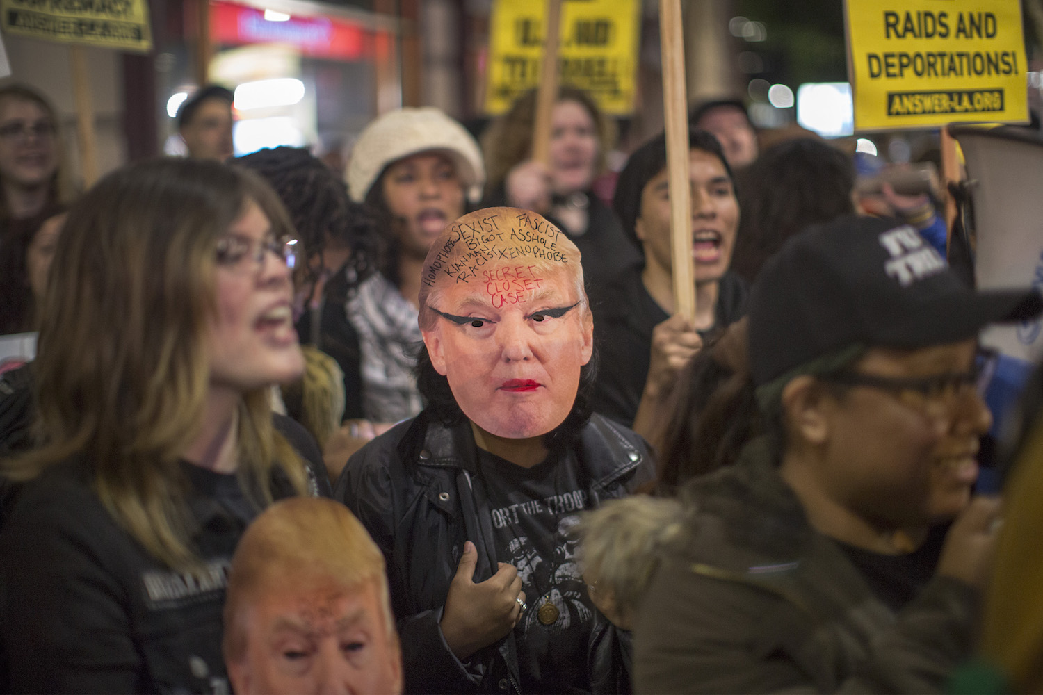 Anti-Trump protesters rally outside the InterContinental Los Angeles Downtown hotel where U.S. President Donald Trump is spending the night during his first visit to California since taking office on March 13, in Los Angeles, California. Earlier today, the president visited border wall prototypes, addressed Marines and held a high-dollar fundraiser. (Photo by David McNew/Getty Images)