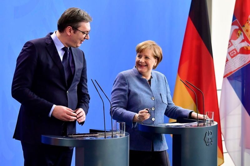 German Chancellor Angela Merkel and Serbia's President Aleksandar Vucic address a joint press conference following their talks at the Chancellery in Berlin on February 27, 2018.