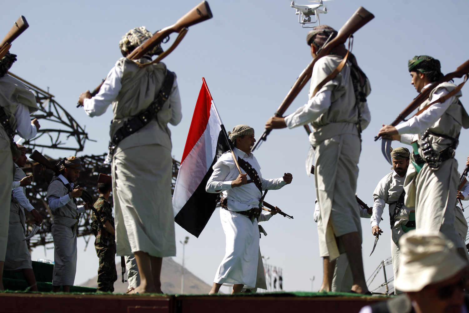 Performers dance during a rally to mark three years of war on the country, in the capital Sanaa on March 26, 2018. A Saudi-led military coalition intervened in Yemen on March 26, 2015 to restore the government of President Abedrabbo Mansour Hadi after the Iran-backed Huthis and their allies took over large parts of the country including the capital Sanaa.  / AFP PHOTO / MOHAMMED HUWAIS        (Photo credit should read MOHAMMED HUWAIS/AFP/Getty Images)