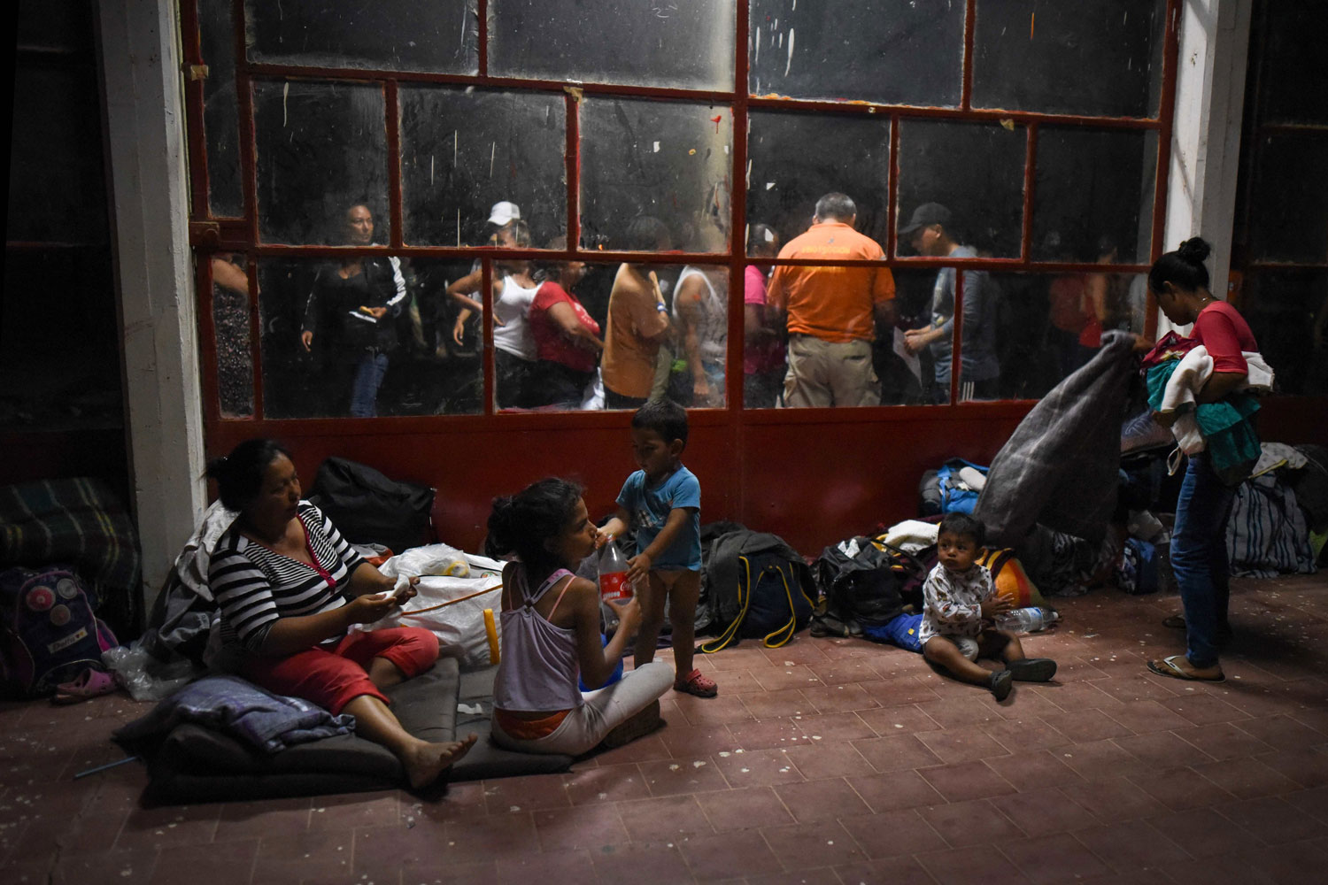 Central American migrants taking part in a caravan rest at a sports center field in Oaxaca, Mexico, on April 2. President Donald Trump lashed out over immigration, triggered by images of the caravan of hundreds headed north in what has become an annual movement to raise awareness about the plight of migrants. (Victoria Razo/AFP/Getty Images)