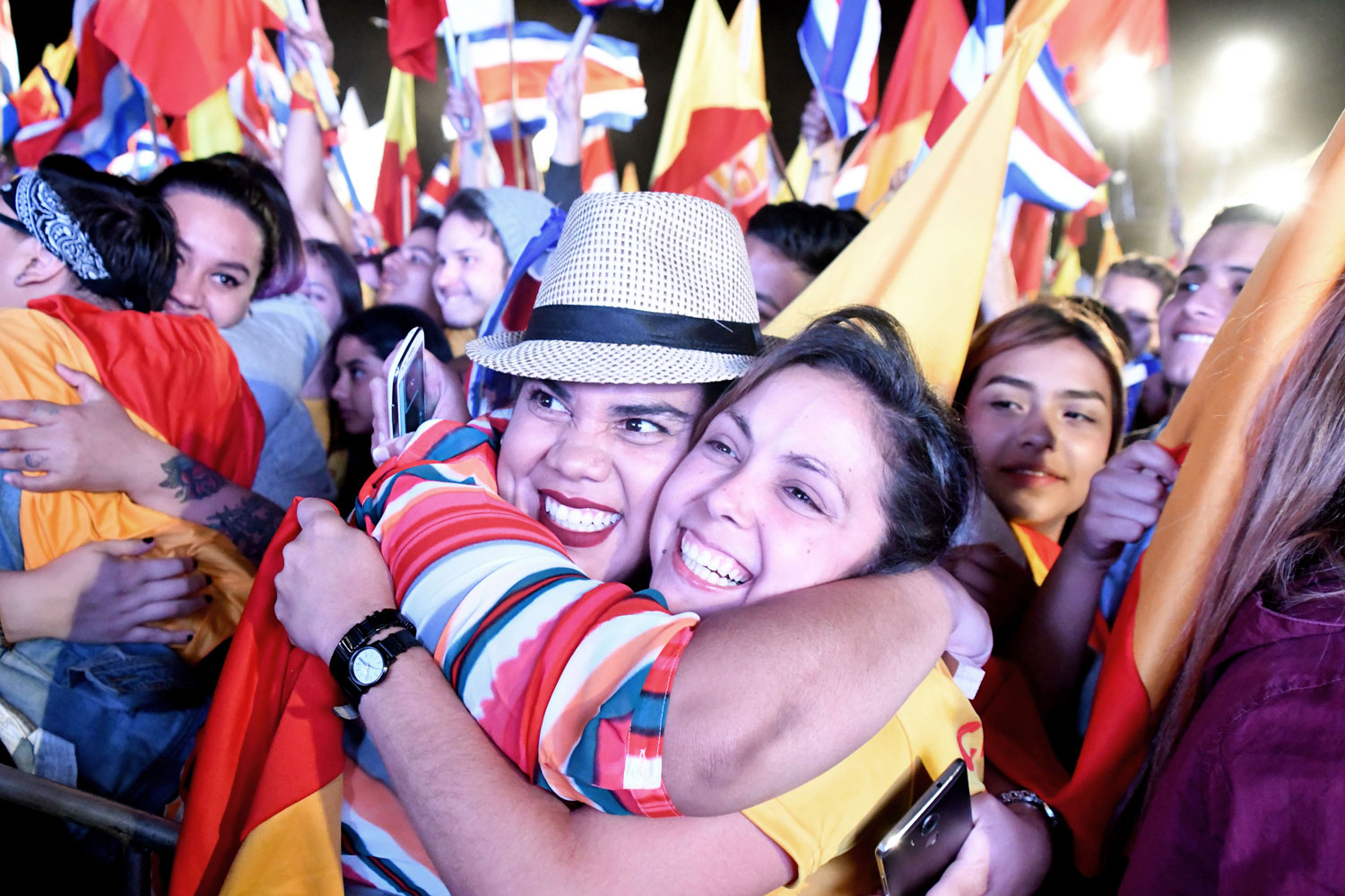 Supporters of presidential candidate Carlos Alvarado of Costa Rica's center-left ruling party celebrate his election in San Jose on April 1. Alvarado, a 38-year-old former labor minister, decisively won the runoff against an evangelical preacher who rose to prominence by campaigning against same-sex marriage. (Ezequiel Becerra/AFP/Getty Images)