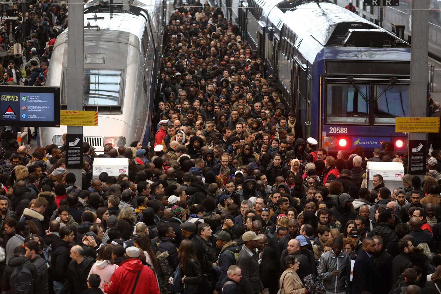 Commuters stand on a crowded platform of the Gare de Lyon railway station on April 3 in Paris on the first day of a two-day strike. The rolling rail strikes, set to last until June 28, are seen as the biggest challenge yet to President Emmanuel Macron's sweeping economic restructuring goals. (Ludovic Marin/AFP/Getty Images)