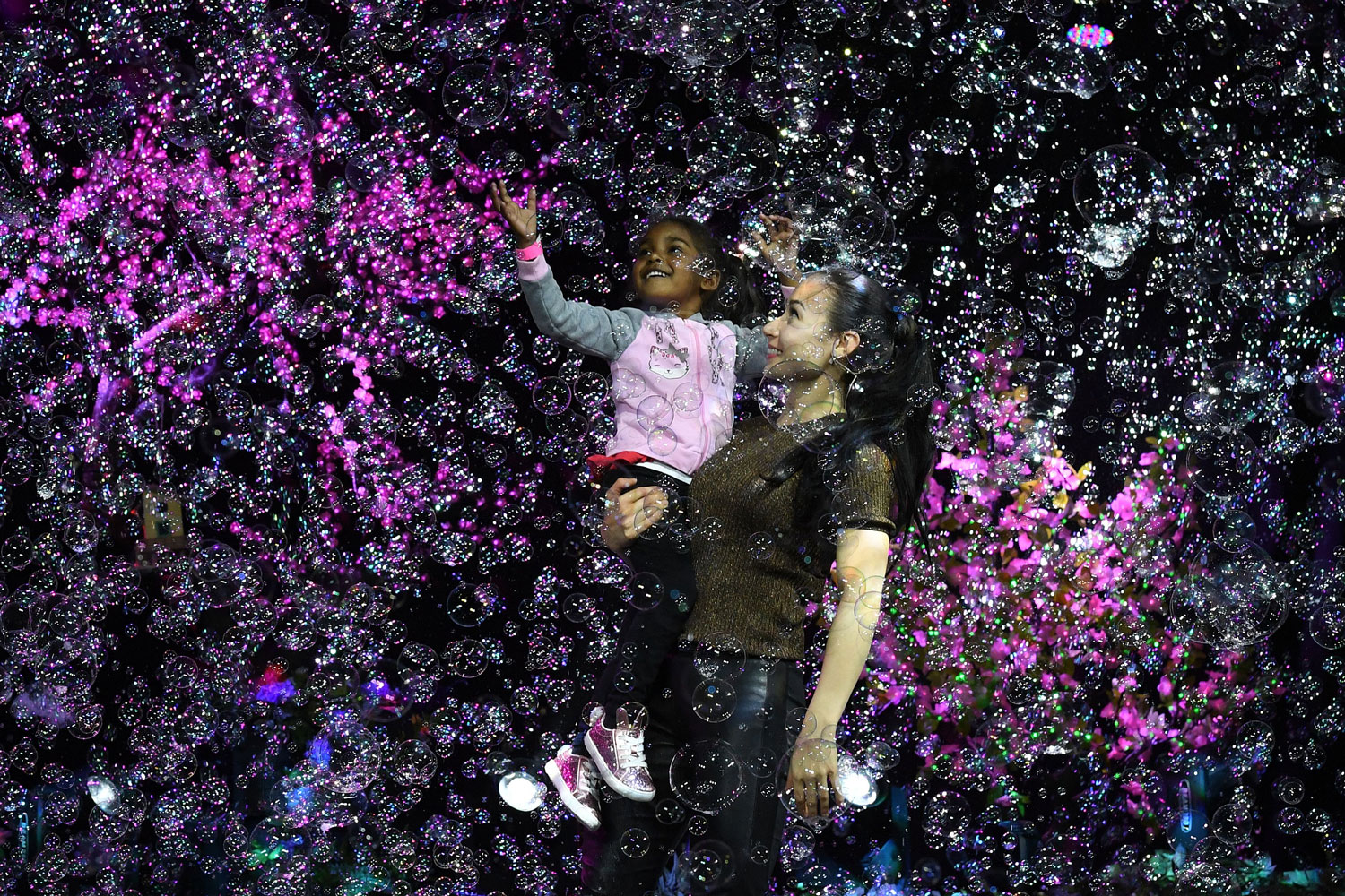 Melody Yang performs during the Mega Bubblefest Laser Show, a family-oriented event in Santa Ana, California, on April 4. Melody, daughter of famed bubble master Fan Yang, has followed in her father's footsteps and travels the world performing her bubble shows. Her family holds the world record for largest soap bubble measuring 167-feet-long, created in Beijing in 2009. (Mark Ralson/AFP/Getty Images)