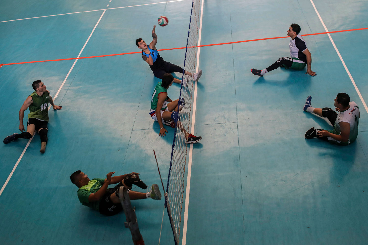 Colombian Army veterans and land-mine victims practice with Antioquia province's sitting volleyball team on April 4 in Medellin, Colombia, during International Mine Awareness Day. According to Colombian President Juan Manuel Santos, 22 people were victims of land mines in the past year, and more than 11,500 since 1990 in the country. (Joaquin Sarmiento/AFP/Getty Images)