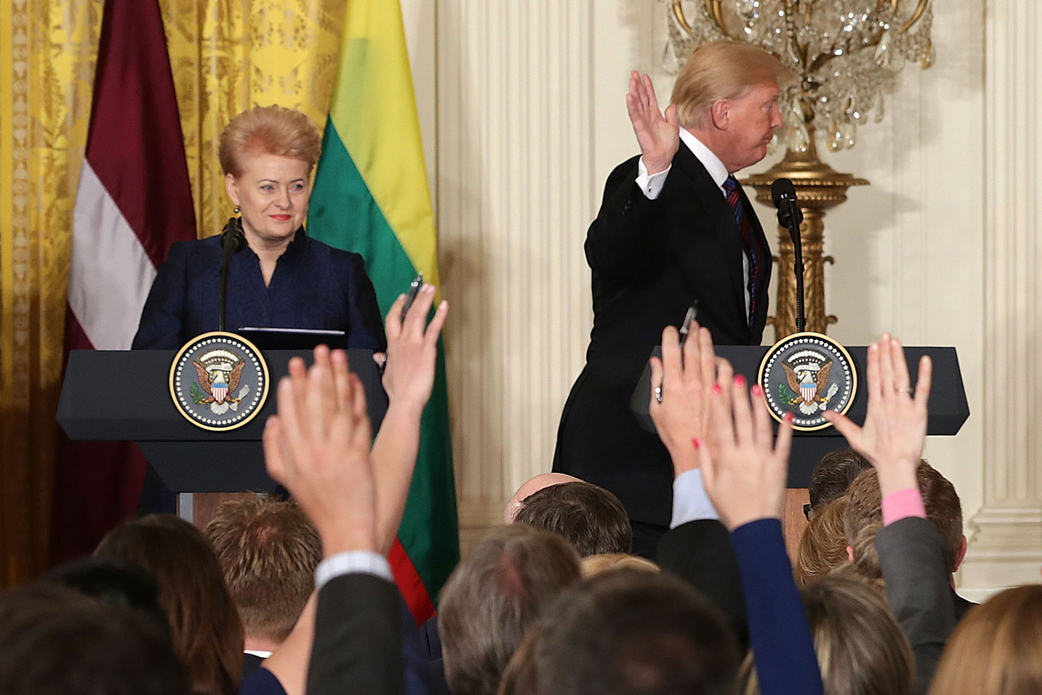 U.S. President Donald Trump waves off questions from American reporters as he leaves the stage April 3 following a news conference with Lithuanian President Dalia Grybauskaite, left, Estonian President Kersti Kaljulaid and Latvian President Raimonds Vejonis in Washington. Marking the 100th anniversary of their independence from Russia, the three Baltic heads of state took part in a summit at the White House. (Chip Somodevilla/Getty Images)