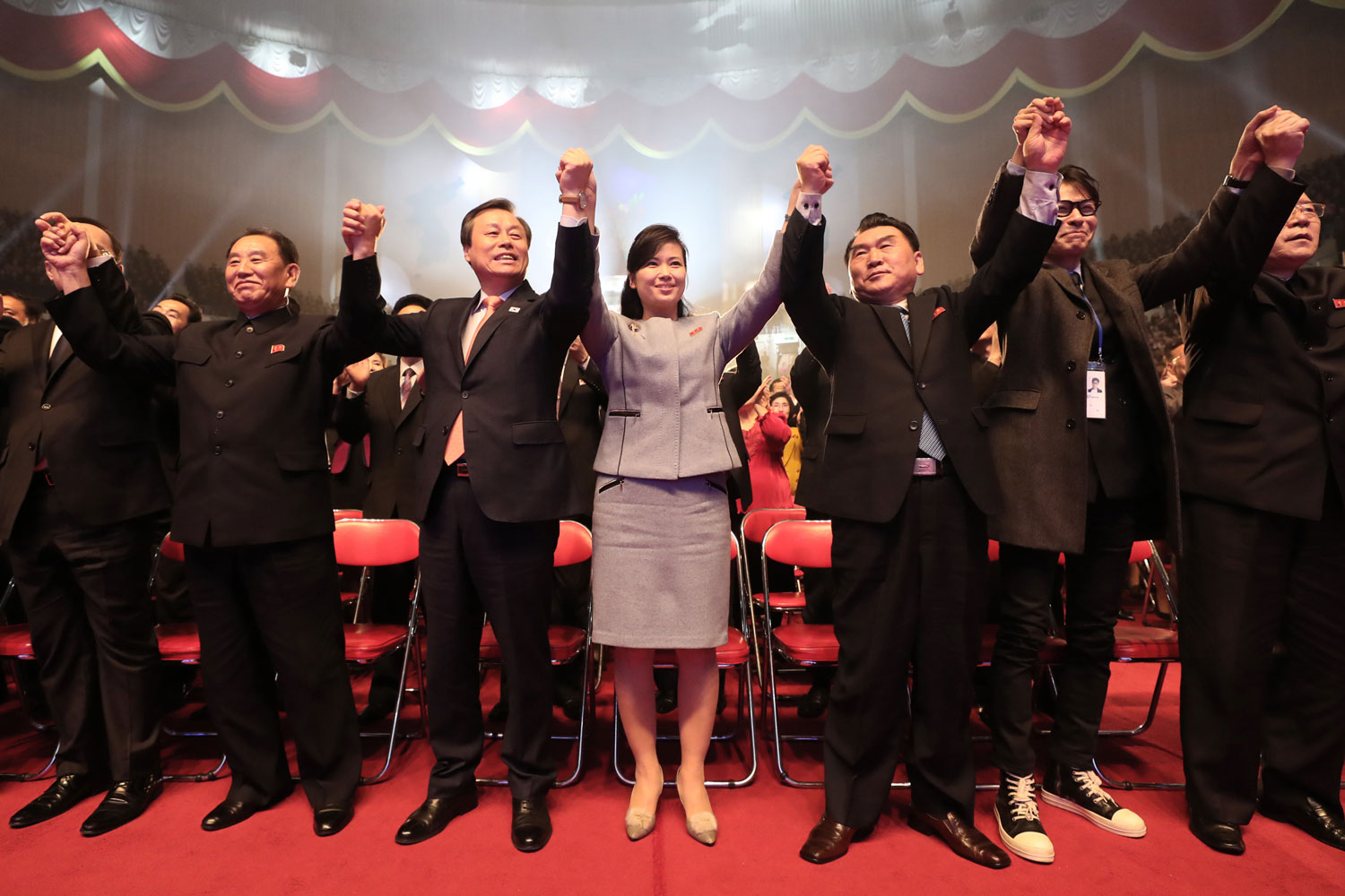 South Korean Culture Minister Do Jong-hwan (fourth from left) and North Korean General Kim Yong Chol (third from left) join Hyon Song-wol (center), founder of the North's popular all-female Moranbong band, and thousands of fans at a joint show by South and North Korean musicians at the 12,000-seat Ryugyong Jong Ju Yong Gymnasium in Pyongyang, North Korea, on April 3. K-pop stars held cross-border cultural performances in North Korea in the latest reconciliatory gesture before a rare inter-Korean summit. (Korea Pool/AFP/Getty Images)
